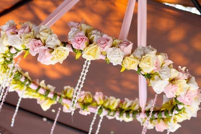 Sleeping Beauty #Party | hula hoop chandelier covered in flowers and dripping with crystals