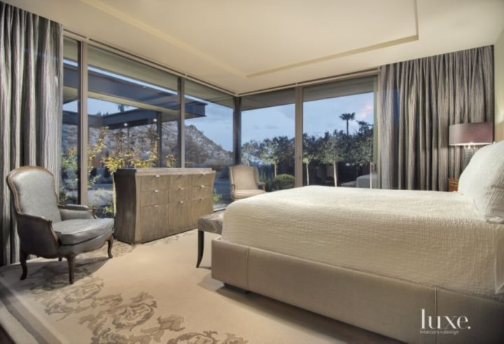 In the master bedroom, the Hayes-designed bed was fabricated by Glant textiles and faces a television console topped with an Edelman leather material from Eric Brand in Burlingame, California. Dressed To Kill Custom Drapery fabricated the draperies that frame the floor-to-ceiling window walls.
