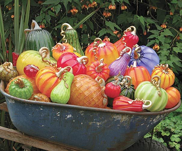 By Cohn-Stone Studios.  I love glass pumpkins, and this wheelbarrow full of blown glass pumpkins and grouds is delightful. #glass #blown