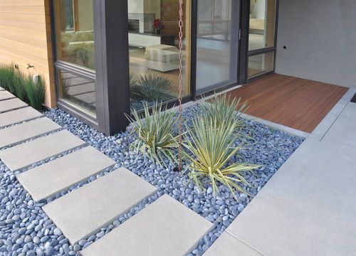 Concrete slabs cast in place, with mexican pebbles surrounding them. #hardscape