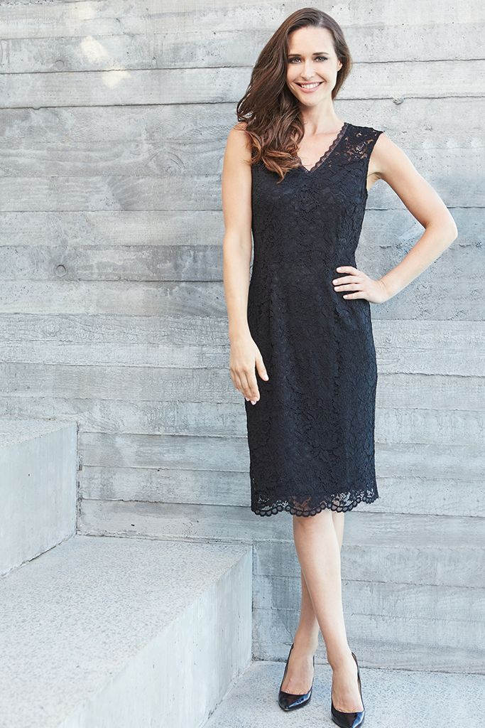 LACE V-NECK DRESS Graceful & elegant, this luxurious Liz Jordan lace dress is an easy choice for your next event. Constructed in a classic black lace with a flattering V-shape neckline & scalloped hem, this form fitting style will be a timeless addition to your wardrobe.