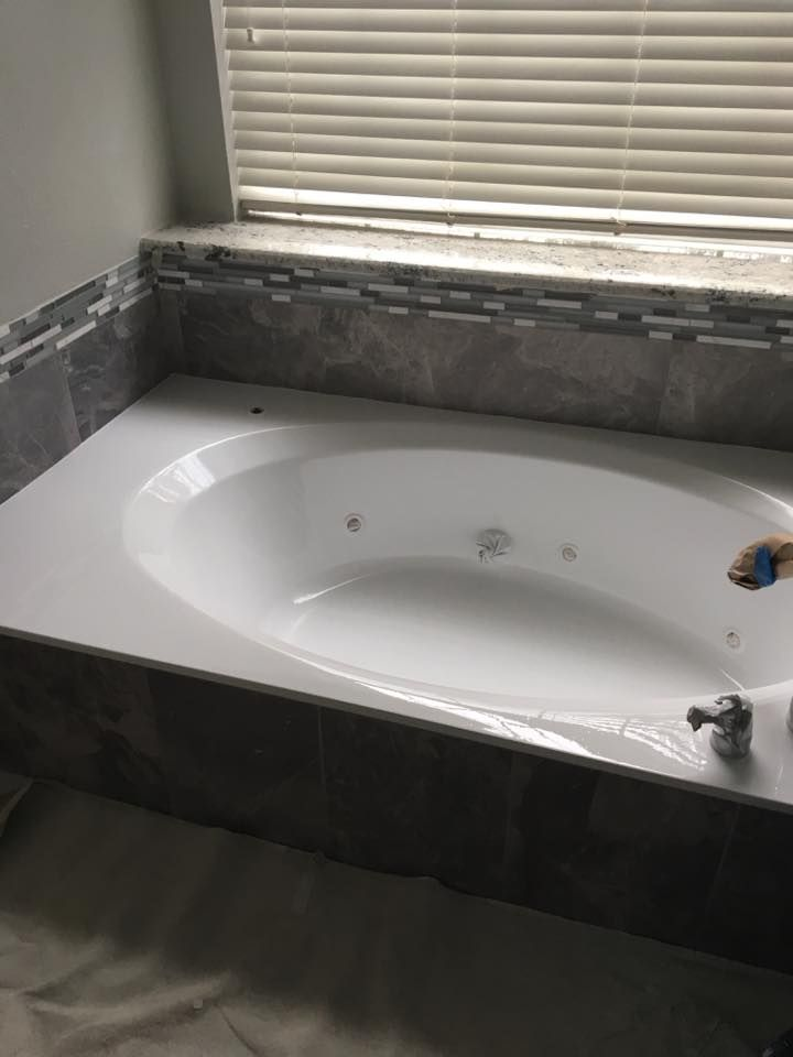 Our talented contractor resurfaced the tub instead of having to replace it (a big expense), so our Bachelor was thrilled at how much savings this came to for him in his master bath update!