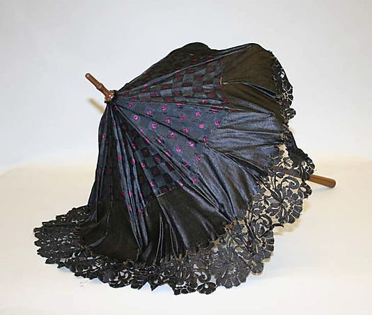 Mourning Parasol, 1860s [Metropolitan Museum of Art] Probably half-mourning considering the colour on the top, but a lovely example of another mourning accessory.