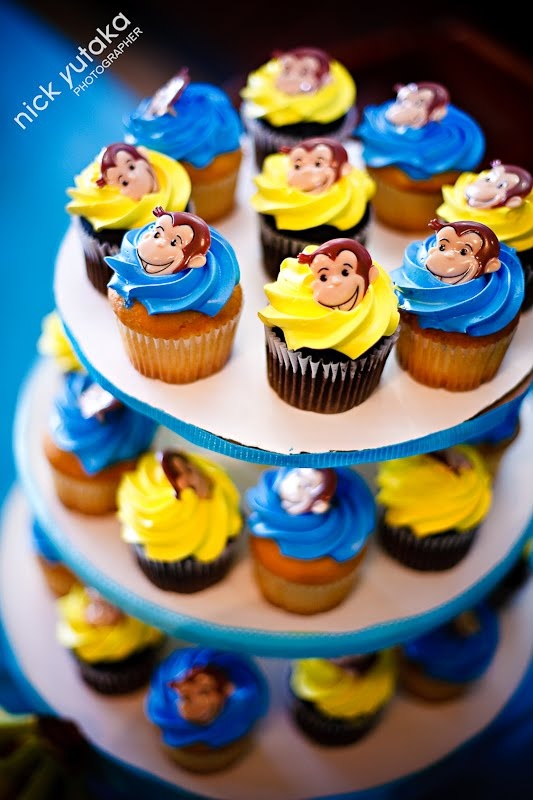 curious George cupcakes with red ones too