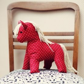 Add some retro charm to the nursery by sewing a toy horse from a vintage pattern.