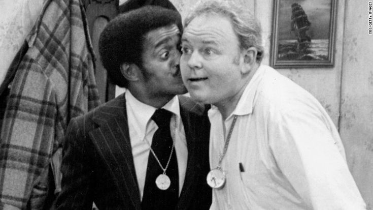 All in the Family; Normal Lear's groundbreaking sitcom, premiered on CBS on January 12, 1971. The show found comedy in some of the most contentious issues, such as race, religion, sexuality and war, primarily through endless, hilarious confrontations between cab-driving conservative Archie Bunker (Carroll O'Connor) and his liberal son-in-law. A highlight of the show's second season was when guest star Sammy Davis, Jr., playing himself, planted a surprise kiss on Archie's cheek.