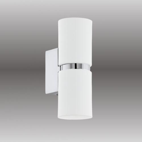 Lampada da parete in alluminio laccato bianco con fascia centrale e base a parete in cromo lucido.  Dack è una lampada biemissione ideale per valorizzare una colonna  o una parete e creare un' illuminazione volutamente soft.