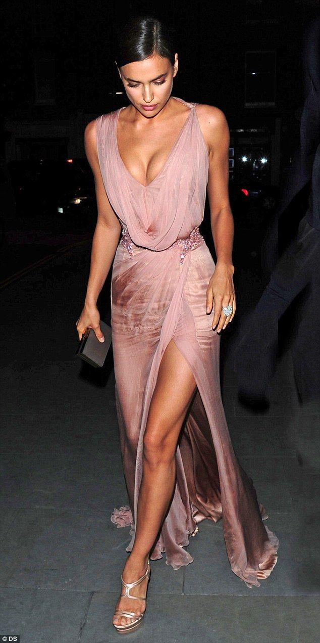Ooh la la! Irina Shayk puts on a leggy display in skimpy black dress #dailymail