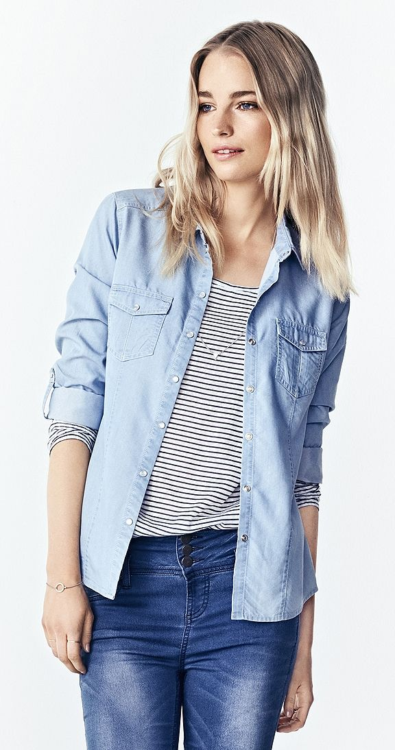 """Blue Crush Shirt - We have a crush on this awesome shirt! If you don't have a denim shirt in your wardrobe, it's a must! You will love it for years to come. This shirt has long sleeves with side tabs to create a cool look . A soft blue colour and subtle front pockets mean this shirt is completely versatile, but we are especially crushing on the snaps.  Fits: True to Size Approx 26"""" length from shoulder to hem Long Sleeve Snap Closure Fabric: 58% Lyocell, 42% Polyester  Chambray Shirt"""