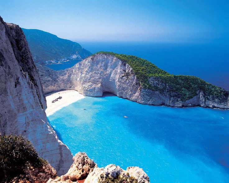 Lefkada Greece- Island West coast beaches like Porto Katsiki and Egremni feature sheer cliffs and turquoise waters. The east coast is known for its traditional villages, including the seaside resort of Nydri. Ted Frank