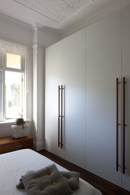 """""""To save cost and be more durable, we chose laminate for all built-in wardrobes but added recycled blackbutt handles that we designed,"""" Michelzahn says. """"The same applies to the large pivot doors."""""""