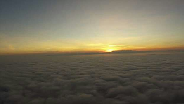 Above the fog n cloud.. Isle of Arran highlighted by the sun goin down.... Irvine Scotland
