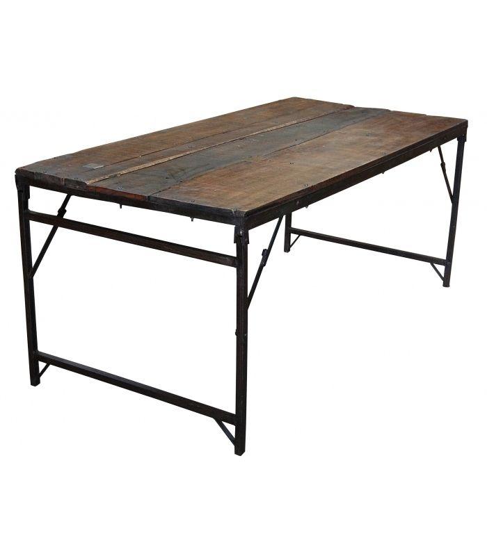 Mesa comedor antigua original con tope de madera y patas plegables de hierro.