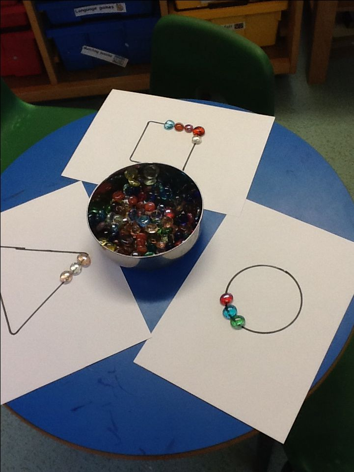 Gemstone outlined shapes. The children made some brilliant patterns with the coloured gems and talked about the properties of the shape as they created the outlines.