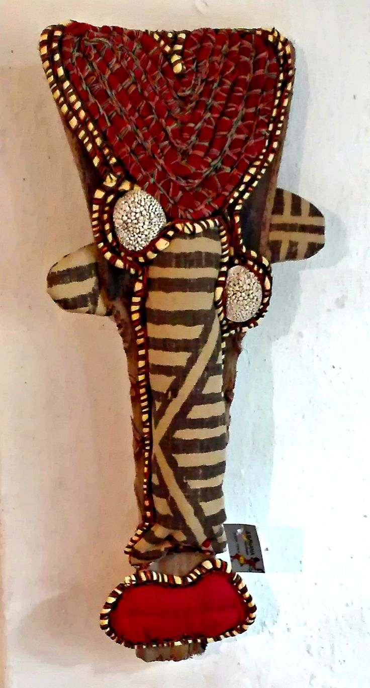 Totem without a tribe mounted on palm leaf, textile and shells