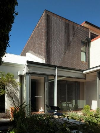 2. The home's façade, built entirely in face brick, responds to the rhythm of the street yet sits in contrast to its neighbours