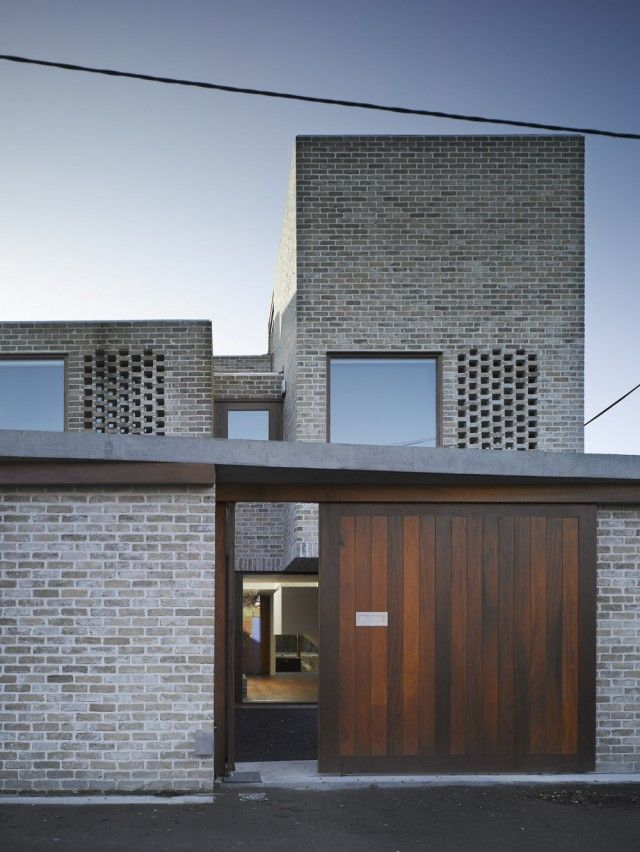 Grafton Architects Waterloo Lane houses entry doors gate barn door wood brick masonry screens ireland More