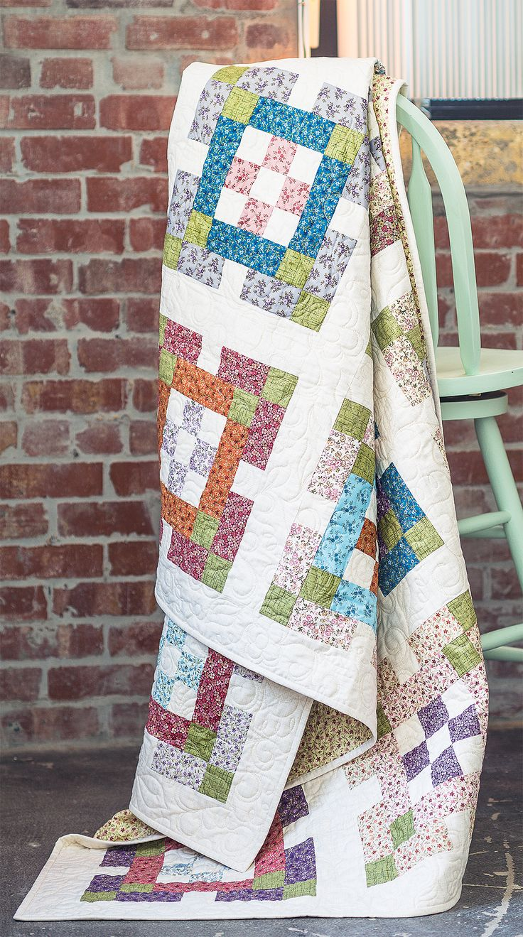 NINE PATCH GARDEN by Colleen Tauke: Soft-colored 2 1/2-inch strips star in this quick-to-piece twin-sized quilt. Nine-patch units are framed with coordinating prints, and then the blocks are joined together with sashing. Adorable for a child's bed!