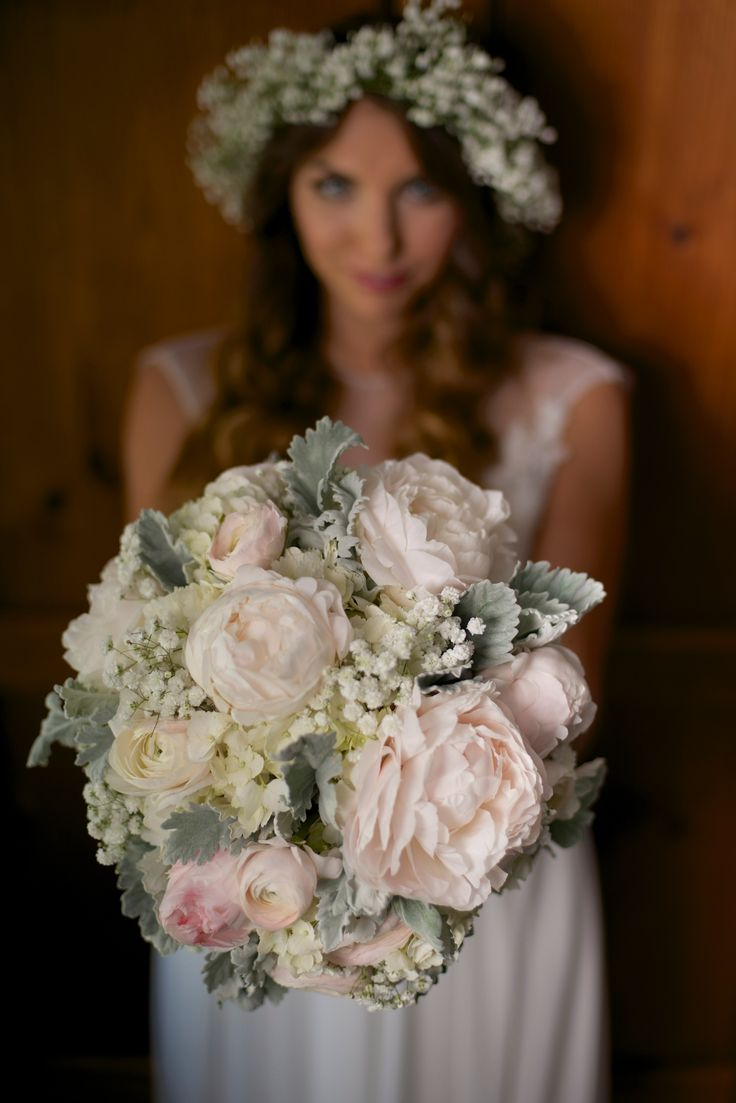 Cream blush and grey bouquet of hydrangea, baby's breath, peonies, garden roses, ranunculus and dusty miller. #chs #weddings #wildflowersinc