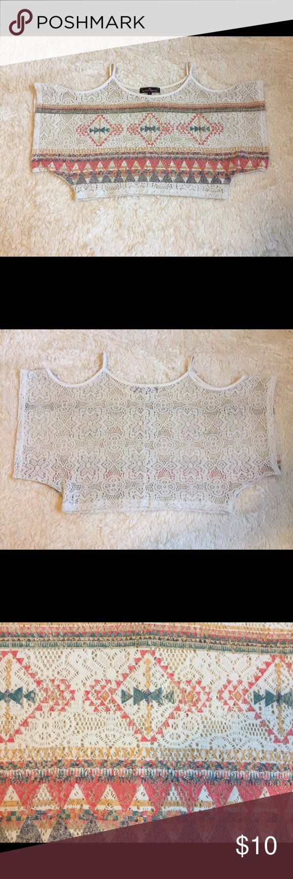 Crochet Aztec Crop Top Off-white Crochet Aztec Crop Top. It is somewhat see-through material , but with a nude bra you won't be able to see anything. The sleeves have cut outs that show the shoulders. In great condition, but does have a little discoloration on the spaghetti straps and neckline , not noticeable because it's already an off-white color (Picture 4). Size S. Almost Famous Tops Crop Tops