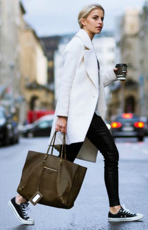 Black converse go with almost anything. We love Caroline Daur's converse look, consisting of leather trousers, a white coat, and a gorgeous brown balenciaga bag. Sweater: Miss Goodlife, Trousers: St. Emile, Shoes: Converse , Case: Balenciaga, Coat: Asos.