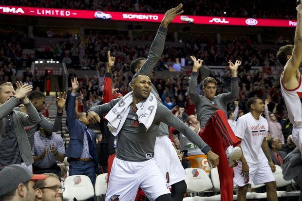 The Portland bench reacts to a Damian Lillard three-pointer as the Trail Blazers top the Indiana Pacers 106-102.