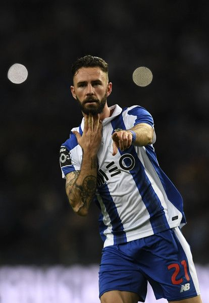 Porto's Mexican defender Miguel Layun celebrates after scoring a goal during the Portuguese league football match FC Porto vs CD Nacional Funchal at the Dragao stadium in Porto on March 4, 2017. / AFP PHOTO / FRANCISCO LEONG