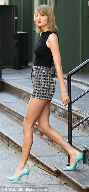 Big achievement: The singer looked happy as she left her New York City apartment Tuesday a...