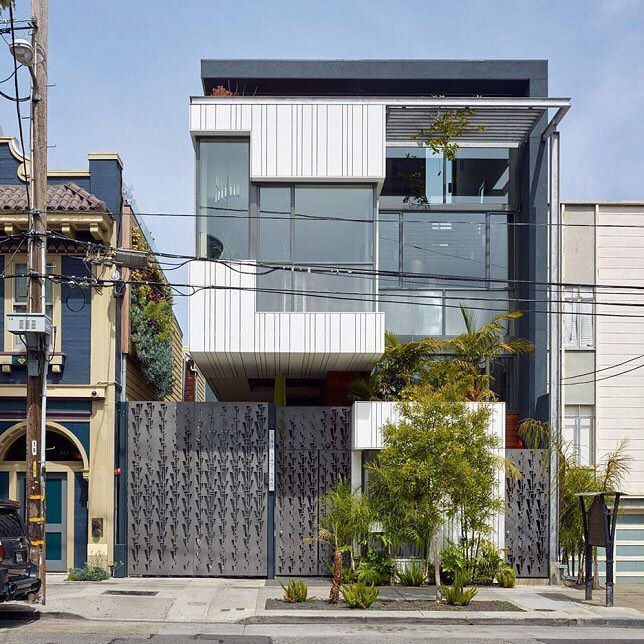 Kennerly Architecture & Planning has completed a San Francisco residential building with a number of distinctive features including a perforated metal gate white plastic cladding and lush landscaping. Read the full story on dezeen.com/usa #architecture #USA #SanFrancisco Photography is by Bruce Damonte and Joe Fletcher. by dezeen