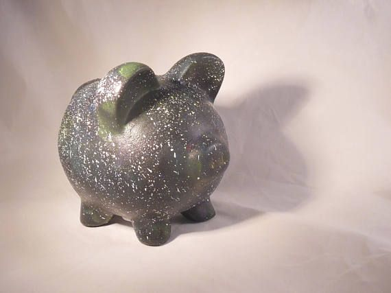 This is a unique hand painted ceramic piggy bank that would make a wonderful gift for all ages. Please keep in mind that printed colors may vary slightly from what you see on your computer screen due to different monitors and settings.   Is packed in a green alternative to traditional bubble with the same protection with up to 40% recycled content with up to 20% from post-consumer sources