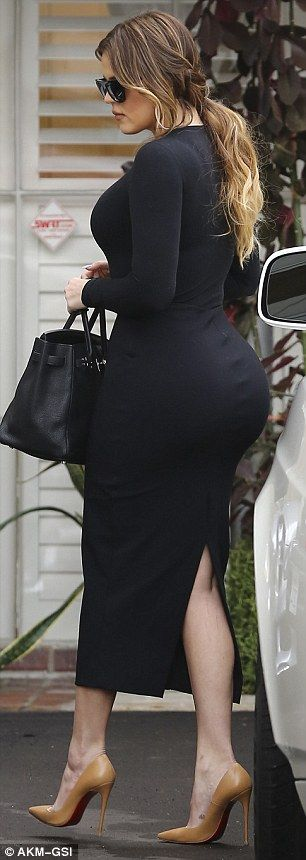 Bling: Khloe wore gold matte pumps with spindly heels and large hoop earrings    2