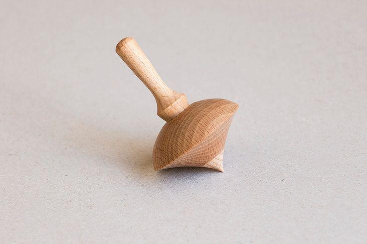 Handmade spinning top made of oak and beech wood