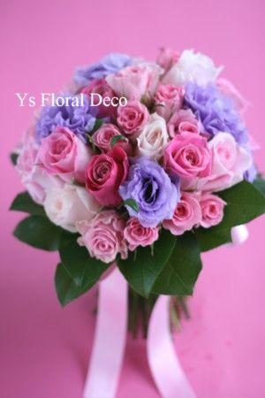 ピンクとラベンダーのクラッチブーケ  @アルジェントASO   ys floral deco