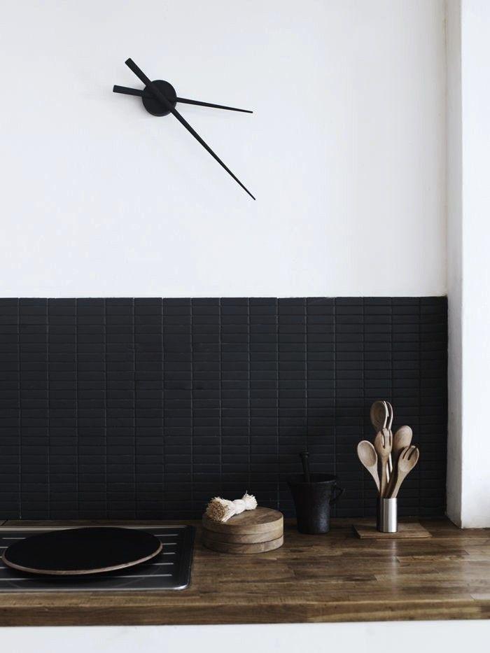 Above: Matte black tiles create a dressed-up backsplash in a Scandinavian kitchen, via Elle Decoration Norway.