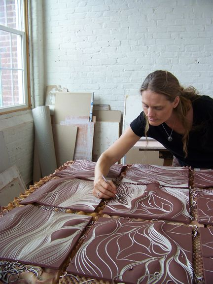 Cynthia Parker-Houghton carving a Tree of Life, ceramic wall tile mural at Natalie Blake Studios in Brattleboro, Vermont