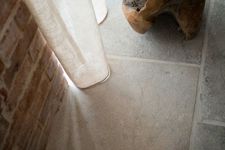 Grey limestone floor with reclaimed bricks wall