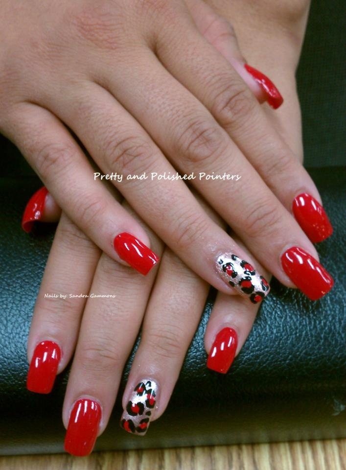 By Pretty Polished Pointers. I used CND Clear acrylic for these sculptured nails. I then polished with NAILTIQUE Red Moscow for this beautiful red manicure and added an accent of leopard in gold, red and black!