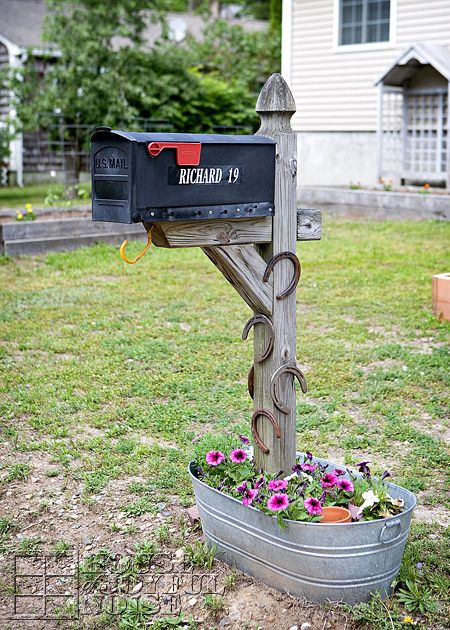 Vintage horseshoes are a cute (and lucky!) addition to a simple wooden mailbox post.