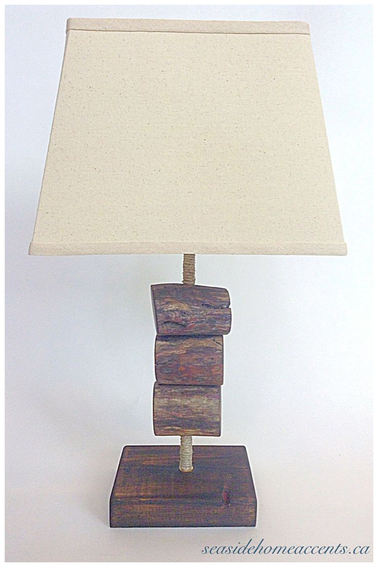 Driftwood table lamp made of 100% reclaimed wood.