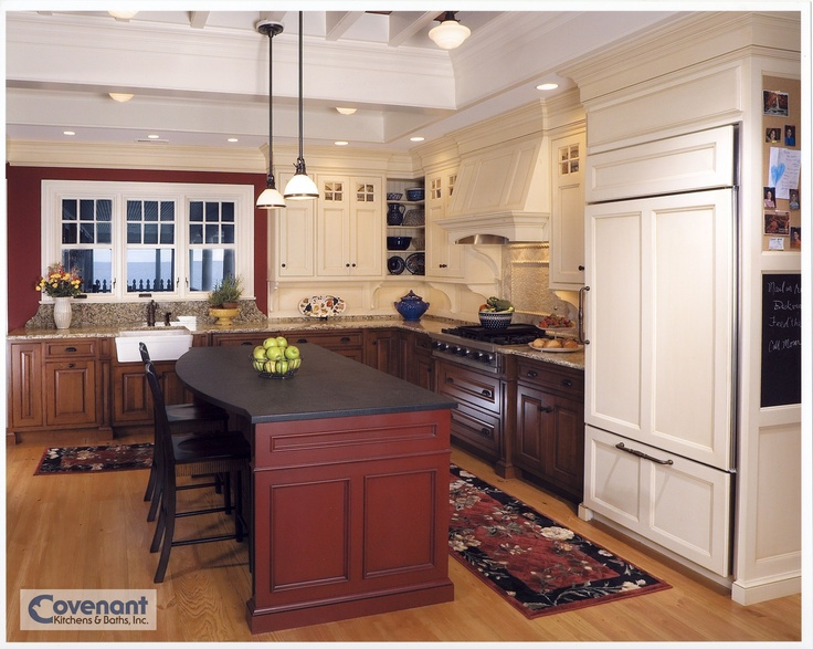 A dark colonial red island accents this kitchen designed and installed by Covenant Kitchens and Baths. www.covenantkitchens.com