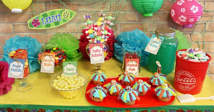 Our Luau Party Candy Bar includes FREE Printable Labels to make this party setup a snap. https://www.sweetcandy.com/our-blog/luau-party-candy-bar-buffet/