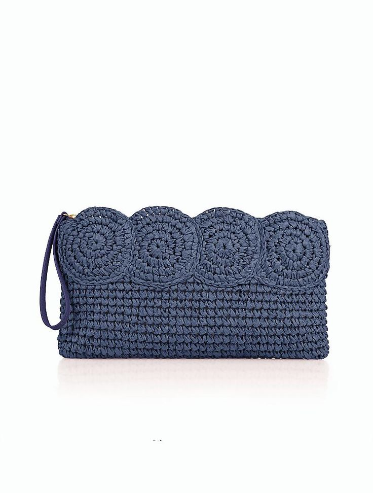 This navy straw clutch is a summer party essential.
