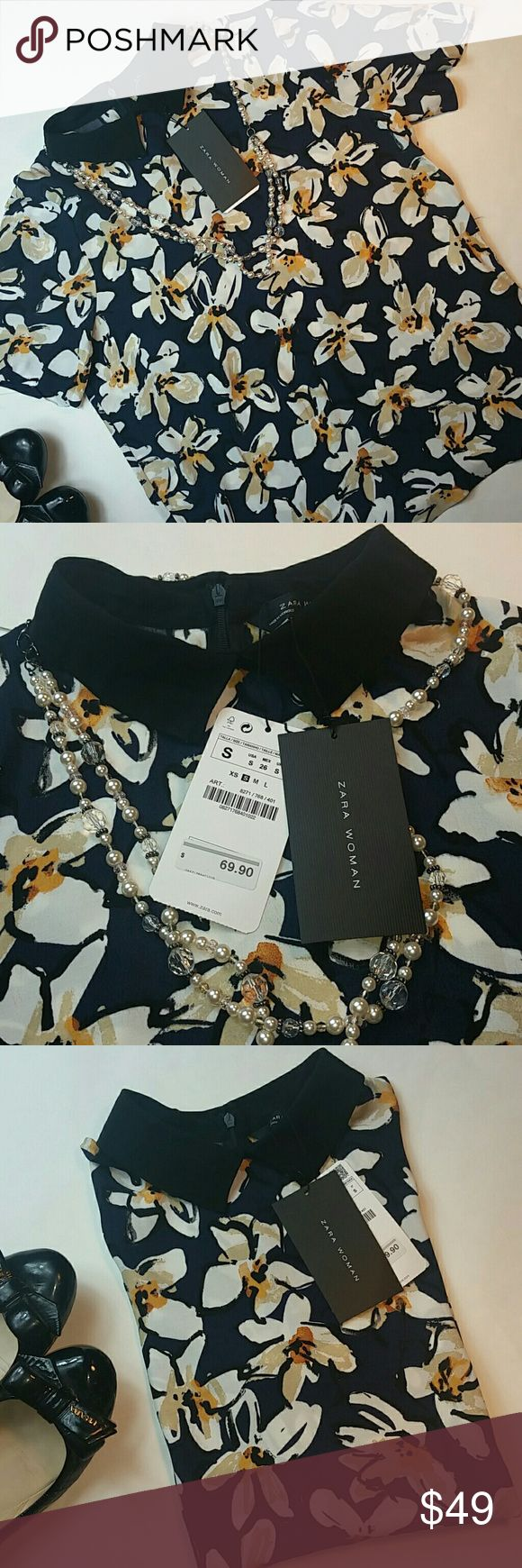 NWT ZARA WOMAN Floral top Navy blue top with beige tan and mustard flowers. Back zipper and with short sleeves. Versatile top! Zara Tops
