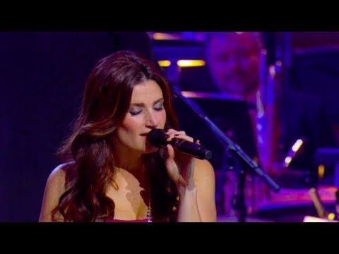 """You can order the full DVD today on Amazon: http://bzz.is/IdinaMenzel!    Enter to win a meet & greet with Idina on her upcoming tour at http://www.facebook.com/IdinaMenzel    Idina Menzel performs """"Tomorrow"""" from """"Annie"""" with the Kitchener-Waterloo Symphony, conducted by Marvin Hamlisch.    Idina may be coming to a city near you! Visit http://www.IdinaMenzel.com for tour dates."""
