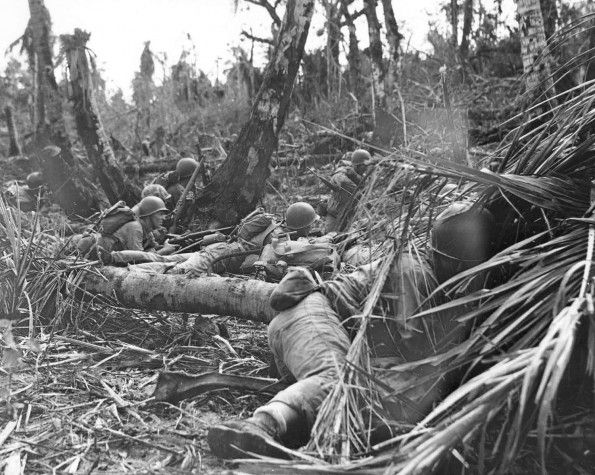 JUL 26 1944 Marines fight off Japanese 'Banzai' charge on Guam Marines dig in after hitting the beach. Taking cover from Jap snipers until they can eliminate them.