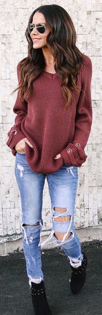 #winter #outfits maroon v-neck sweater with blue denim distressd fitted jeans