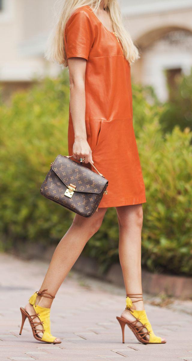 Blonde in orange leather dress