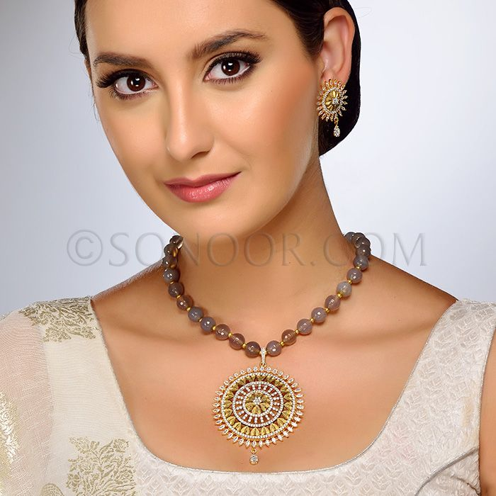 PEN/1/3703 Alopa Pendant Set with Earrings in frosted gold finish studded with cubic zircons stringing in smokey beads