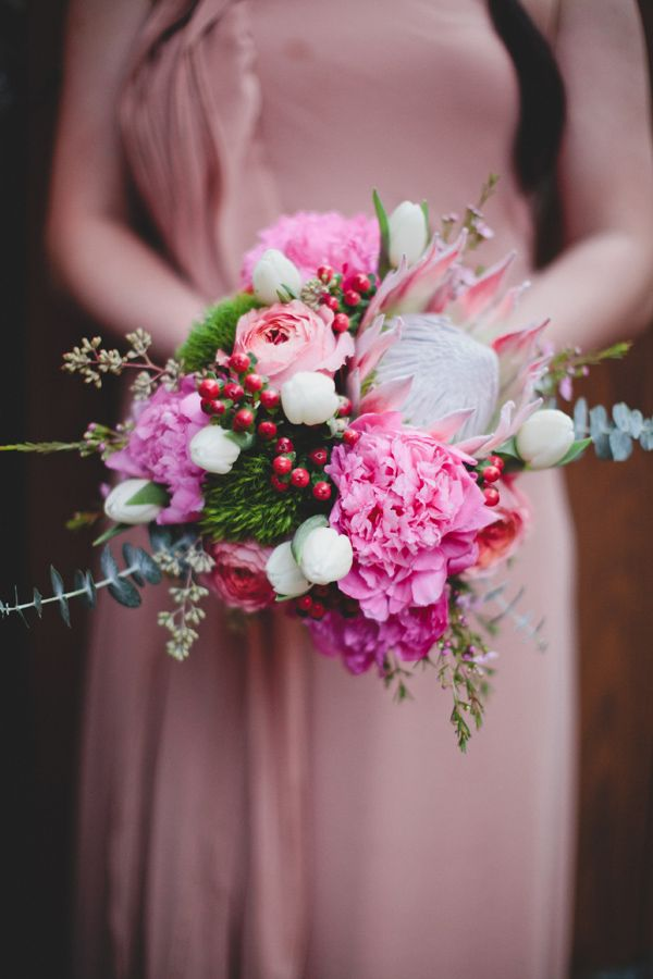 pink protea wedding bouquet // photo by TaylorLordPhotography.com