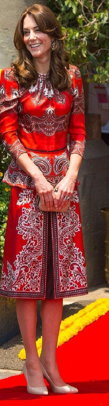 Kate Middleton wore Alexander McQueen a peplum blouse and skirt in a red paisley scarf print http://www.dailymail.co.uk/news/article-3532239/Namaste-Kate-William-arrive-India-pay-tribute-victims-2008-Mumbai-terror-attacks-start-royal-tour-couple-nearly-two-years.html